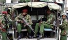 Kenyan soldiers stand by