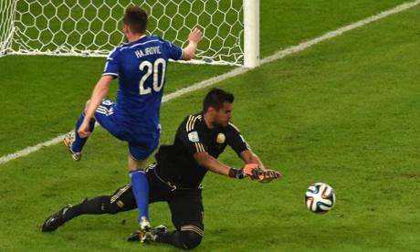 Bosnia-Hercegovina's midfielder Izet Hajrovic is denied by Argentina's goalkeeper Sergio Romero.