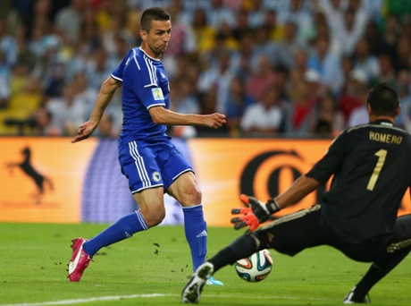 Vedad Ibisevic of Bosnia and Herzegovina gives his side a lifeline with a late goal.