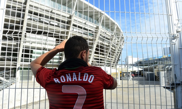 A fan gets ready for Portugal v Germany outside the Arena Fonte Nova in Salvador