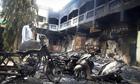 A man surveys Mpeketoni after the massacre by al-Shabaab Islamist militants, w