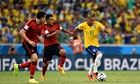 Brazil's forward Neymar (R) is chased by