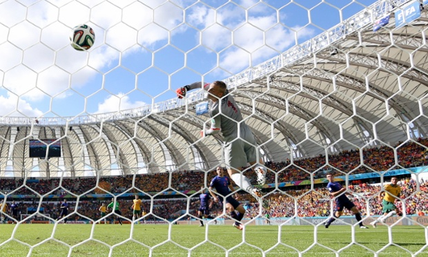 Australia's Tim Cahill scores his side's first goal during the Group B match between Australia and Holland.