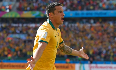 Tim Cahill celebrates after scoring his side's first goal during the Group B match between Australia and Holland.