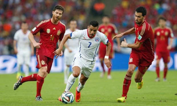 Chile's forward Alexis Sanchez charges forward against Spain.