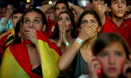 Spain fans react as their side concedes to Chile.