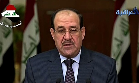 A grim-faced Nouri al-Maliki speaks on Iraqi TV