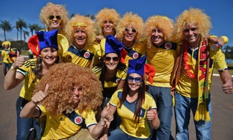 Colombia's fans pose outside the Mane Garrincha National Stadium in Brasilia, before the Group C  match between Colombia and Ivory Coast.