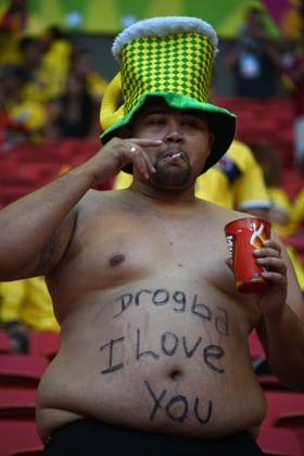 An Ivory Coast fan waits for the start of the Group C football match between Colombia and Ivory Coast at the Mane Garrincha National Stadium in Brasilia during the 2014 World Cup.