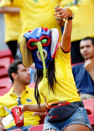 A Colombia fan enjoys the atmosphere prior to the 2014 World Cup Brazil Group C match between Colombia and Cote D'Ivoire.