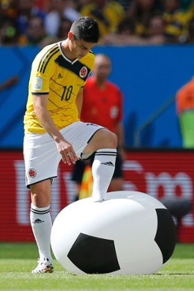 Colombia's James Rodriguez attempts to burst the inflatable ball.