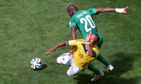 Its a good game without too many clear chances. Ivory Coast's Geoffroy Serey challenges Colombia's James Rodriguez.