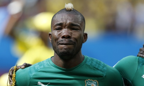 Ivory Coast's midfielder Geoffroy Serey Die is overcome with emotion as he listens to his national anthem before the start of the match.