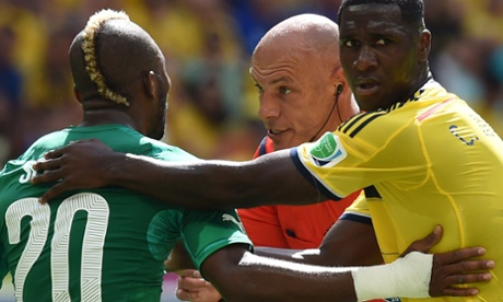 English referee Howard Webb has a quiet word with Geoffroy Serey Die and Cristian Zapata.