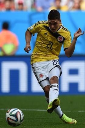 Colombia's midfielder Juan Fernando Quintero  scores the second goal against Ivory Coast.