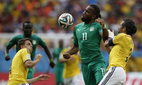 Ivory Coast's forward and captain Didier Drogba  fights for the bal.