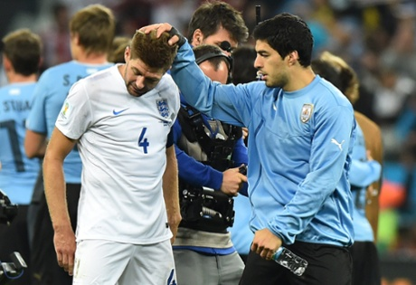 Steven Gerrard is consoled by Luis Suarez.