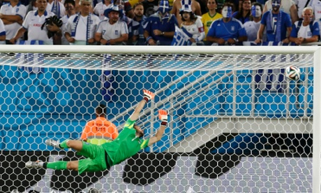 Greece's keeper Orestis Karnezis is relieved to see that one fly wide of the post.