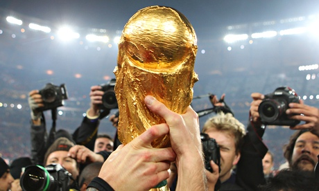 the World Cup trophy is held aloft