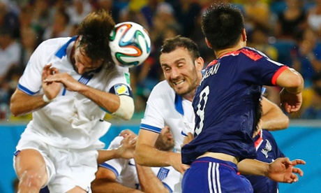 Greece's Giorgios Samaras gets his head to the ball but can't direct it on target.