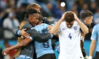 England captain Steven Gerrard shows his dejection as Uruguay celebrate their 2-1 World Cup win