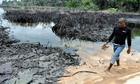 Spilled crude oil iger Delta swamps of Bodo, Nigeria.