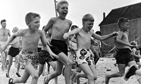Skinny? No, normal. Boys running on the beach in the 1950s.