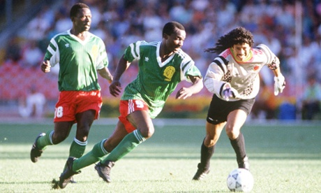 Roger Milla makes a fool of Colombian goalkeeper Rene Higuita back in 1990. Look at the size of that badge. Gorgeous.