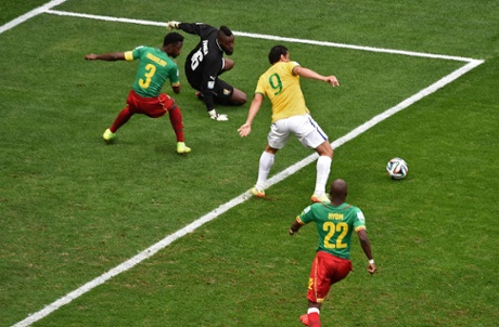 Cameroon's defender Nicolas Nkoulou and goalkeeper Charles Itandje watch the ball as Fred tries to connect.