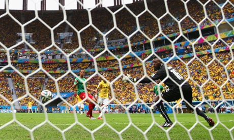 Neymar guides the ball into the back of the net.