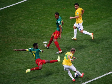 Brazil's Neymar scores his fourth of the tournament.
