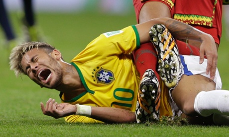 Brazil's Neymar cries in pain after colliding with Cameroon's Joel Matip.