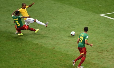 Brazil's midfielder Fernandinho strikes and scores the fourth...