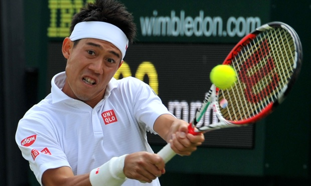Japan's Kei Nishikori returns against France's Kenny De Schepper.