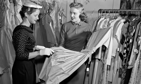 Woman choosing dress in shop