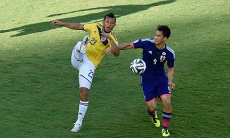 Japan's forward Shinji Okazaki (right) vies with Colombia's defender Carlos Valdes.