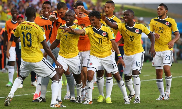 Juan Guillermo Cuadrado of Colombia celebrates with teammates after scoring with a penalty.