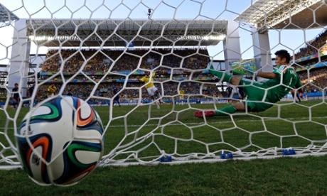Colombia's Juan Cuadrado scores the opening goal.