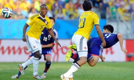 Japan's Shinji Okazaki (right) scores the equalizer.