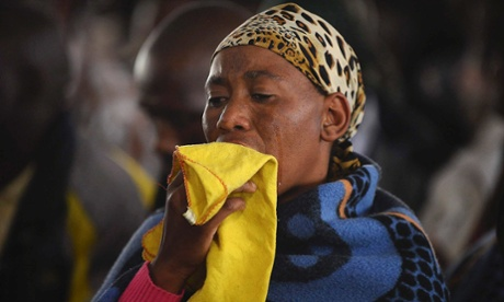 A relative weeps during a memorial service in honour of mineworkers killed by police in Marikana in South Africa.