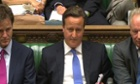 Cameron and Miliband clash at PMQs over Coulson: Politics live blog