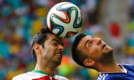 Iran's Pejman Montazeri and Bosnia's Vedad Ibisevic go head to head.