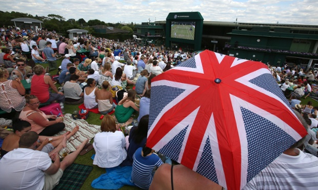 Crowds on Murray Mount watch Andy Murray on the big screen as the No 3 seed beat Blaz Rola.