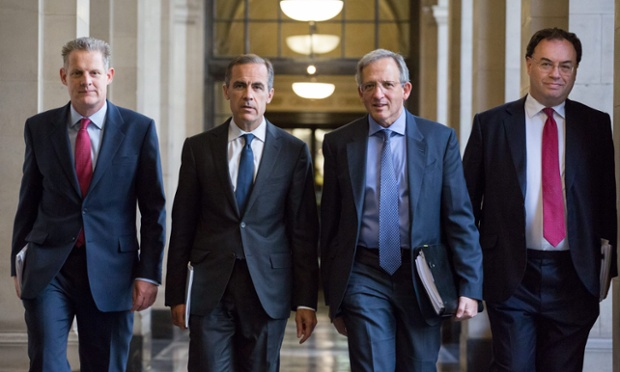 Spencer Dale, Mark Carney, Jon Cunliffe and Andrew Bailey, walking together towards the press conference room for the The Bank of England Financial Stability report at the Bank of England, in London, Britain, 26 June, 2014.