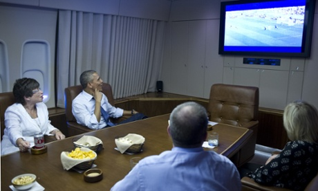 Obama watches the game on Air Force One.