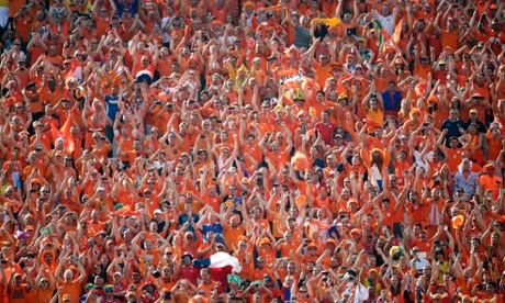 Dutch fans applaud their national team after their 2-0 victory over Chile in the group B World Cup game in São Paulo, Brazil, on 23 June 2014.