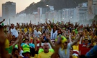 Brazil fans on Copacabana beach watch the match against Cameroon which Brazil won 4-1.
