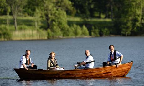 david-cameron-angela-merkel-boat-sweden