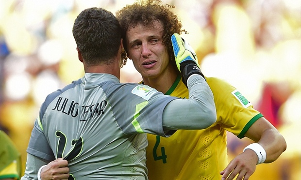 Brazil's defender David Luiz cries as he hugs his team's goalkeeper Julio Cesar after they won their match against Chile following a penalty shoot-out.