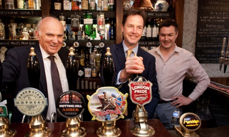 Nick Clegg pulling a pint with Vince Cable  in the Queen's Head pub in central London this morning.